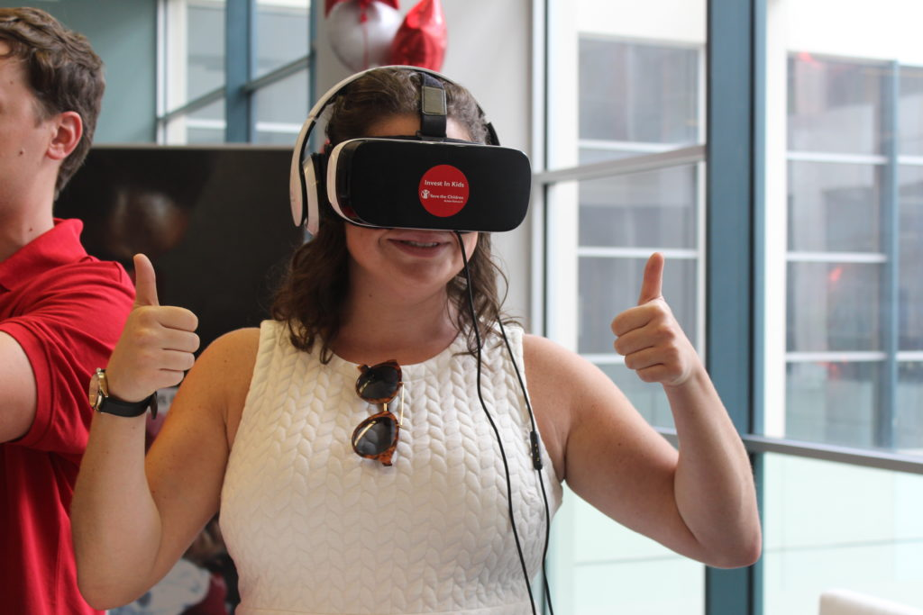 A visitor to our installation at the RNC giving a thumbs up about the virtual reality experience