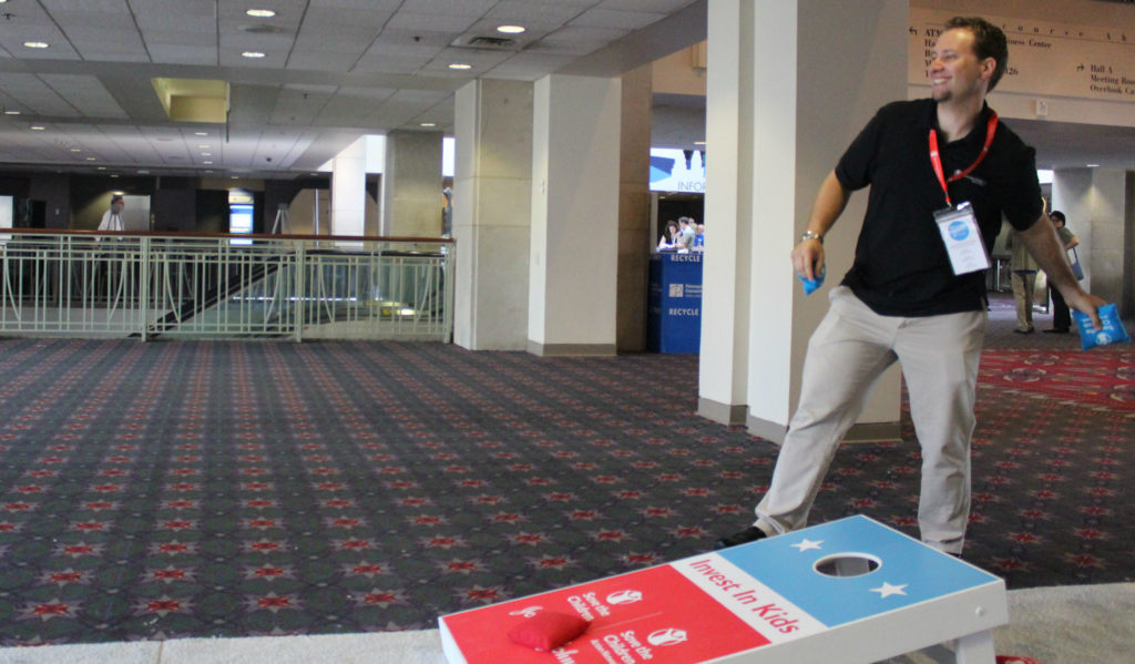 SCAN staff Mike playing corn hole at the DNC