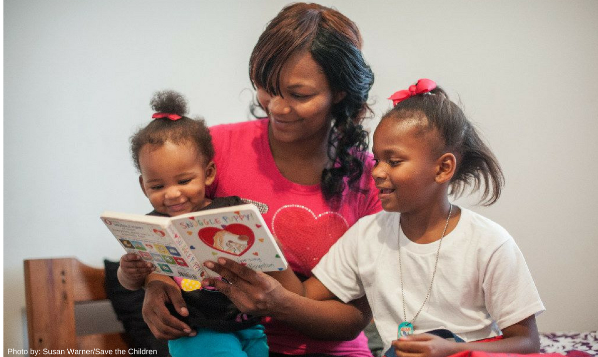 Porshia reading to her kids