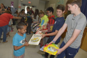 Students giving books away from Carlthorp School