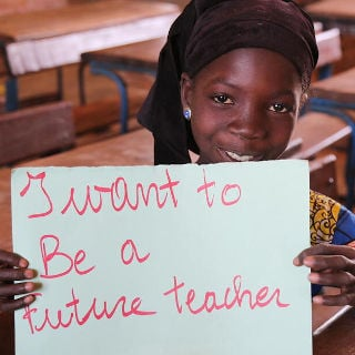 Photo of girl with sign I want to be a future teacher