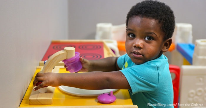 Child getting water in child care classroom