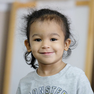 Photo of young girl in child care program