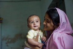 Iffat, 19, with her youngest baby, five-month-old Ahmad,
